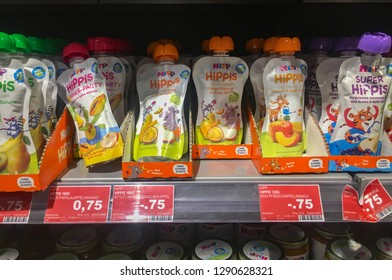 Braunschweig, Germany - December 13, 2018 : Variety of vegetables and fruits Hipp, baby and kid products, kid snacks on the shelf for selling. Kid food concept. pouch food for kid.