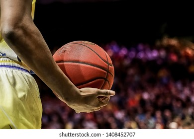 Braunschweig, Germany, March 16, 2019: close-up on basketball player Shaquille Hines holding the official game ball during a game between Lowen Braunschweig and Rasta Vechta at the Volkswagen Halle.