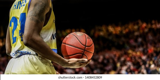 Braunschweig, Germany, March 16, 2019: basketball player Shaquille Hines holding the official game ball during a game between Lowen Braunschweig and Rasta Vechta at the Volkswagen Halle.