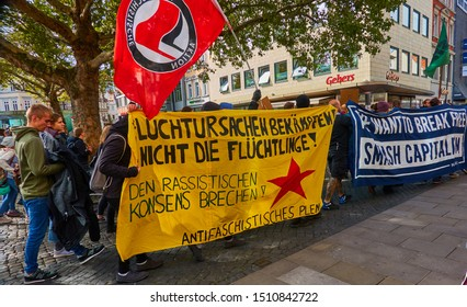 Braunschweig, Germany, September 20., 2019: The anti-fascist bloc at the Fridays for future demonstration Germany, Braunschweig, with posters against racism and capitalism