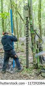 Braunschweig, Lower Saxony, Germany, May 4, 2018: Drilling with the auger for the construction of a well to observe groundwater in a forest, environmental issue