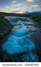 Braurfossar is mazing waterfall with colorful clouds and blue sky over