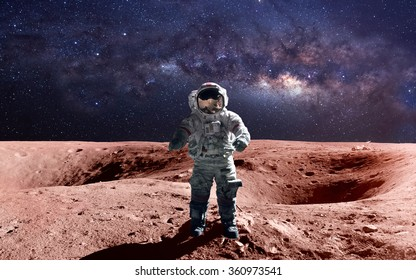 Brave astronaut at the spacewalk on the mars. This image elements furnished by NASA.