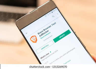 Brave Browser app on Google Play Store website displayed on smartphone and computer laptop in background. Slovenia 13.02.2019