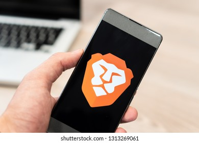 Brave Browser logo displayed on smartphone and computer laptop in background. Slovenia 13.02.2019