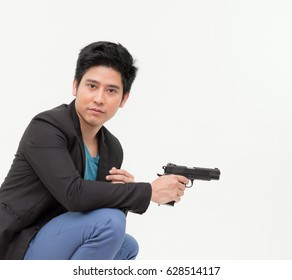 Brave cool man holding a dangerous weapon on white background, businessman and gun in hand, Businessman man with hand gun