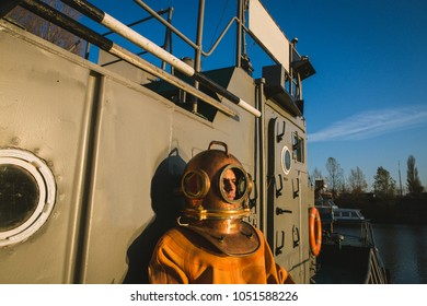a brave diver stands on the deck of a ship