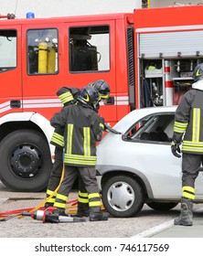 brave firemen cut off the car with shears to free the wounded after the road accident