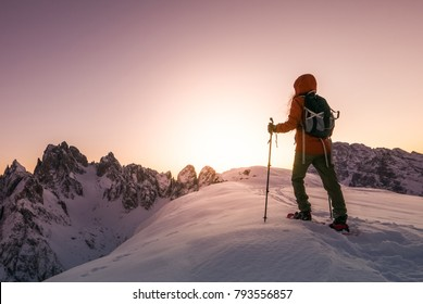 Brave woman exploring high Alpine mountains