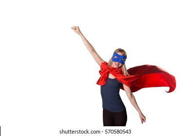 Brave woman superhero raised her hand up on white background. Courage superwoman in red cape and blue mask posing in studio, isolated.