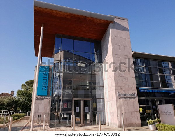 BRAY, CO. WICKLOW, IRELAND - JUNE 24, 2020: Front view of the entrance to the building of the Mermaid County Wicklow Arts Centre in Bray town. Sunny summer day.