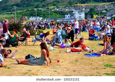 BRAY, IRELAND – JULY 21: Unidentified people attending The Bray Air Show on July 21, 2013 in Bray, County Wicklow, Ireland. The show attracted a record-breaking crowd of 85,000.