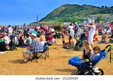 BRAY, IRELAND - JUNE 21: Unidentified people attending The Bray Air Show on July 21, 2013 in Bray, County Wicklow, Ireland. The show attracted a record-breaking crowd of 85,000.