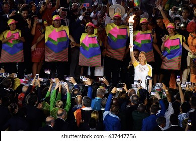 BRAZIL 05 AUGUST 2016 - Former basketball player Hortencia Marcari carries the Olympic flame during the Opening Ceremony of the Rio 2016 Olympic Games at Maracana Stadium, Rio de Janeiro, Brazil.