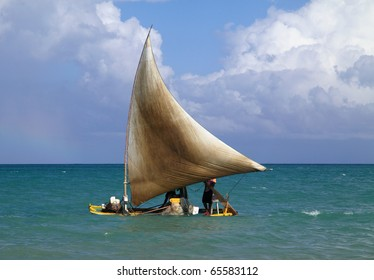 Brazil Alagoas State Maceio traditional fishing raft with sail on a calm Atlantic ocean