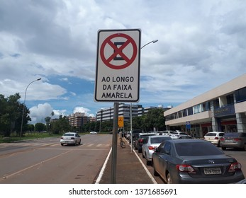 Brasília, Brazil, April 14, 2019: Signage plate, galvanized steel, electrostatic paint, reflective adhesive, informing the driver of the vehicle, which is prohibited to park, along the yellow strip.