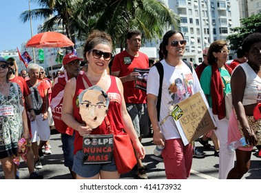 Brazil - April 17, 2016: Demonstrators make their way down Atlantica Avenue in Copacabana beach, in Rio de Janeiro, during a protest against the impeachment of President Dilma Rousseff.