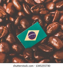 a Brazil, Brasil flag placed over roasted coffee beans