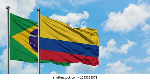 Brazil and Colombia flag waving in the wind against white cloudy blue sky together. Diplomacy concept, international relations.