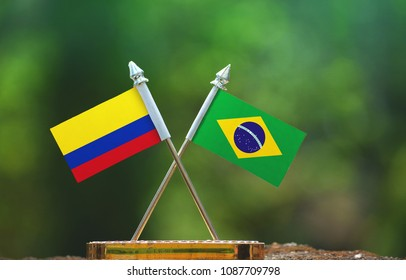 Brazil and Colombia small flag with blur green background
