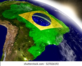 Brazil with embedded flag on planet surface during sunrise. 3D illustration with highly detailed realistic planet surface and visible city lights. Elements of this image furnished by NASA.