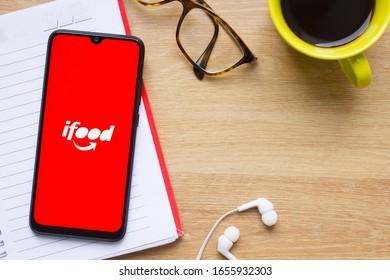 Brazil, February 25, 2020 - Ifood logo on smartphone screen in illustrative scenario