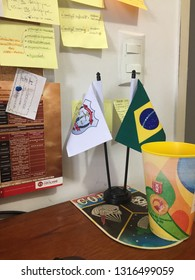 Goiânia, Brazil, February 4, 2019: Various school materials for study or work, annotations of tasks to be performed. In the table two small flags: Brazil and another one of the Civil Police.