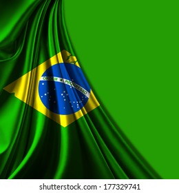 Brazil flag fabric and green background