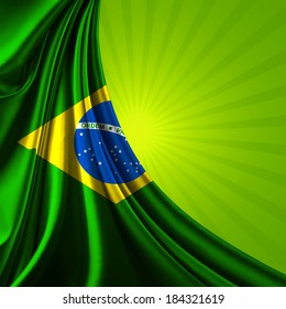 Brazil flag fabric and green rays background