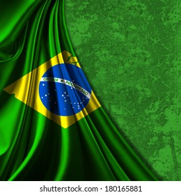 Brazil flag fabric and green wall background