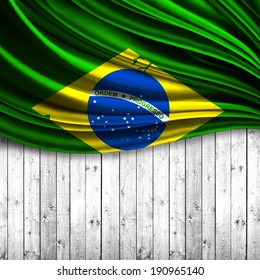 Brazil flag fabric and wood background