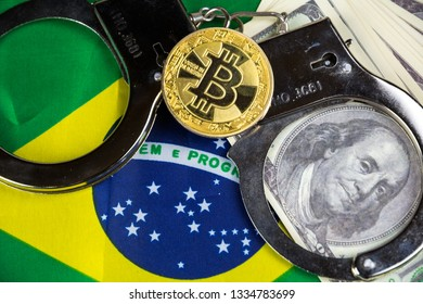 Brazil flag with handcuffs and a bundle of dollars and bitcoin. Currency corruption in the country. Financial crimes