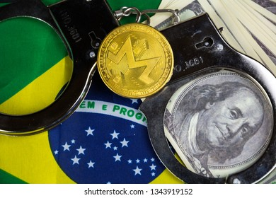 Brazil flag with handcuffs and a bundle of dollars and monero coin. Currency corruption in the country. Financial crimes