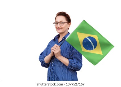 Brazil flag. Woman holding Brazilian flag. Nice portrait of middle aged lady 40 50 years old holding a large flag isolated on white background.