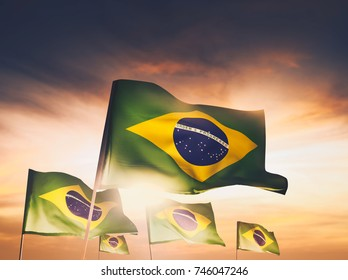 brazil flags waving with pride at sunset /high contrast image