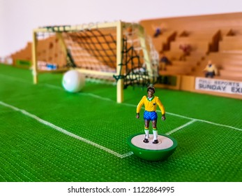 Brazil football figures lined up on a grass field