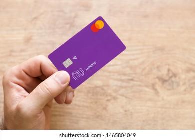 Brazil; July 29, 2019: Man holding a Nubank Creditcard. Nubank is a Brazilian company in the segment of financial services and digital bank. largest fintech in Latin America, Brazilian unicorn.