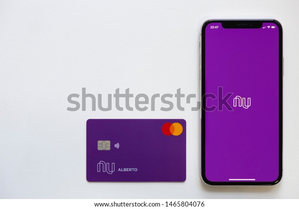 Brazil; July 29, 2019: Nubank logo on the screen of the mobile device and creditcard. Nubank is a Brazilian company in the segment of financial services and digital bank. largest Brazilian fintech