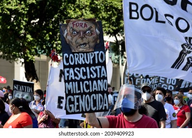 Brazil - July 3, 2021: Marchers gathered in Rio de Janeiro holding signs with slogans such as 'Corrupt, fascist, militiaman, genocidal' to protest against Brazilian far-right president Jair Bolsonaro