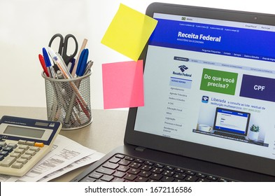 Brazil, March 12, 2020 - Brazilian Receita Federal page open on the notebook screen on top of an office bench