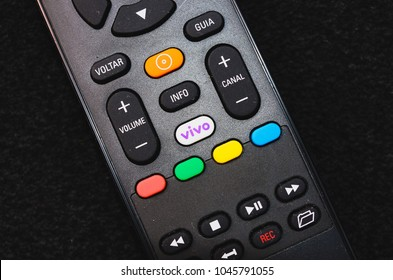 Brazil - March 13, 2018: Black cable tv remote control with the VIVO button.
