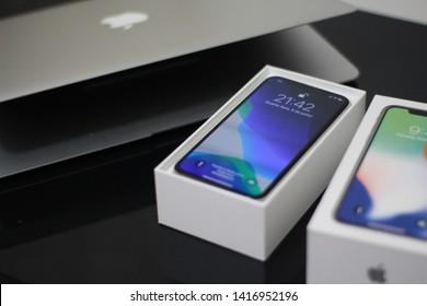 BRAZIL, MS, CAMPO GRANDE - JUNE 05, 2019:  Apple products (Macbook Air and iPhone X in the box) on the table