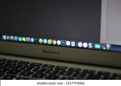 BRAZIL, MS, CAMPO GRANDE - JUNE 06, 2019: MacBook air connected with applications open in the dock and Photoshop CC 2019 on screen
