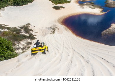 BRAZIL, NATAL - AGO 4, 2017: Colored Buggy ridding in dunes of Genipabu