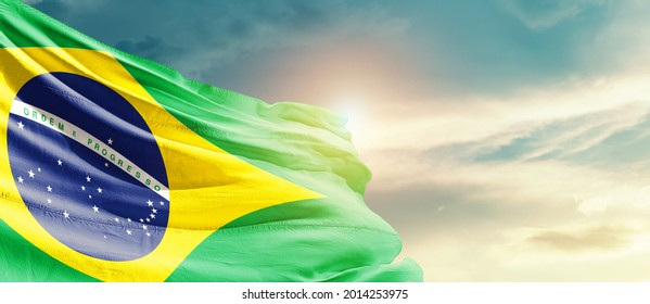 Brazil national flag waving in beautiful sky.