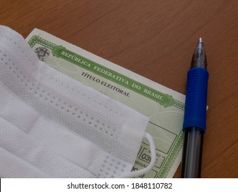Brazil - November 2, 2020: detail of the title of Brazilian voter, face mask and pen. The mandatory items for voting in municipal elections will occur throughout Brazil.