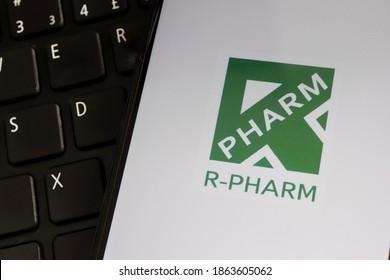 Brazil - November 27, 2020. R-Pharm logo on smartphone screen on top of laptop. R-Pharm is a Russian pharmaceutical company.