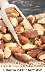 Brazil nut in the scoop on sackcloth close up