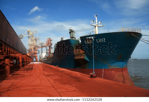 Pará, Brazil, October 13, 2006. Port of Vila do Conde. Merchant cargo ship being loaded with bauxite in the port of Vila do Conde in the state of Pará.