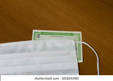 Brazil - September 20, 2020: Electoral title (título eleitoral) and face protection mask for mandatory use for voting